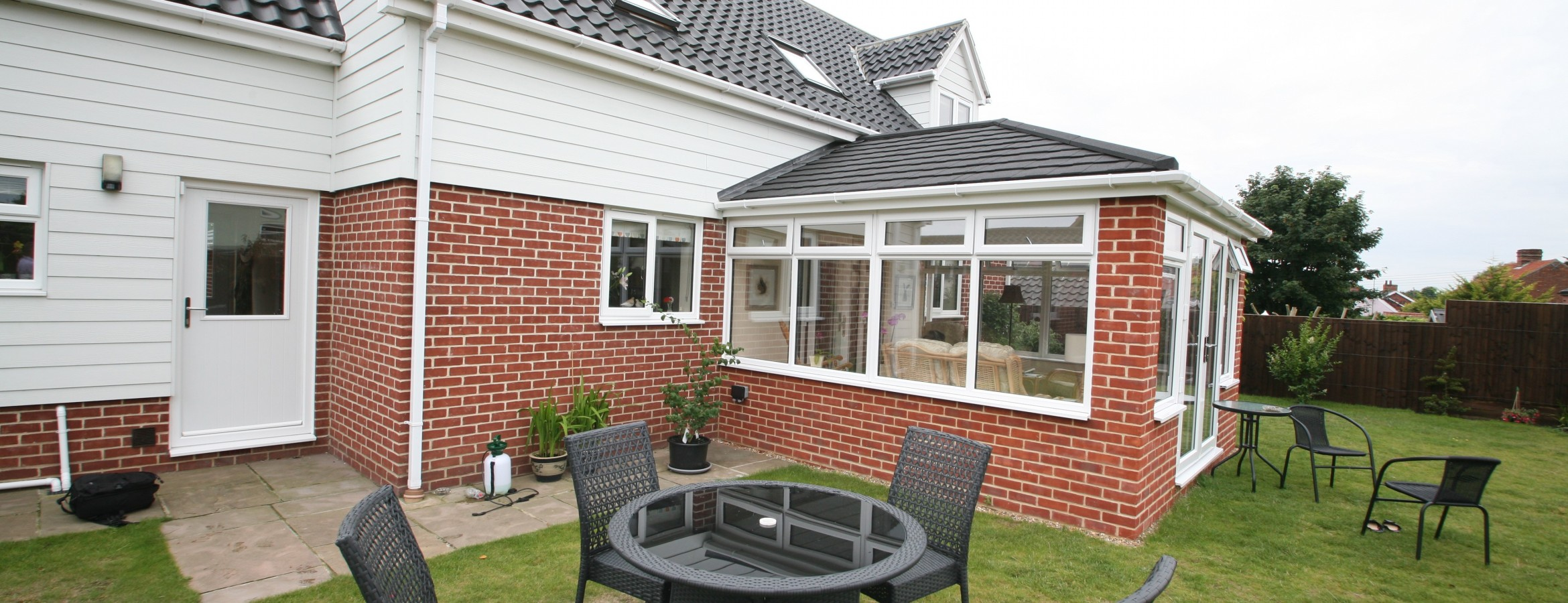 Conservatory with an insulated roof
